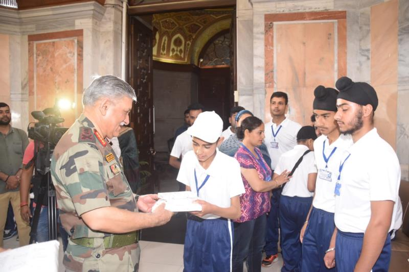 Master Mehraj cl 8th student takes memento from the Chief of Army Staff Maj Gen Rawat at CBT tour at Delhi.